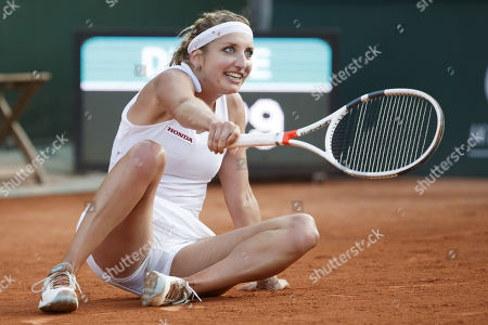 Timea Bacsinszky, of Switzerland, falls during the first round match against Jil Teichmann, of Switzerland,, at the WTA International Ladies Open Lausanne tournament, in Lausanne, Switzerland, Tuesday, July 16, 2019.