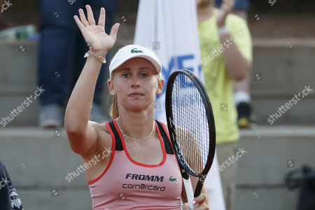 Stock Photo of Jil Teichmann, of Switzerland, celebrates her victory against  Timea Bacsinszky, of Switzerland, during their first round match, at the WTA International Ladies Open Lausanne tournament, in Lausanne, Switzerland, Tuesday, July 16, 2019.