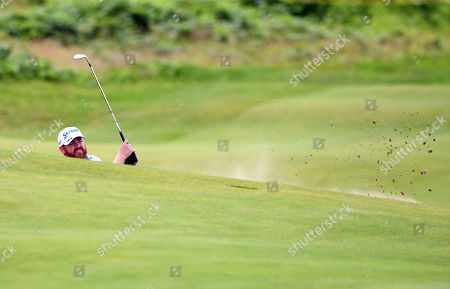 J. B. Holmes of the US blasts out of a bunker on the second practice day prior to the British Open Golf Championship at Royal Portrush, Northern Ireland, 16 July 2019.