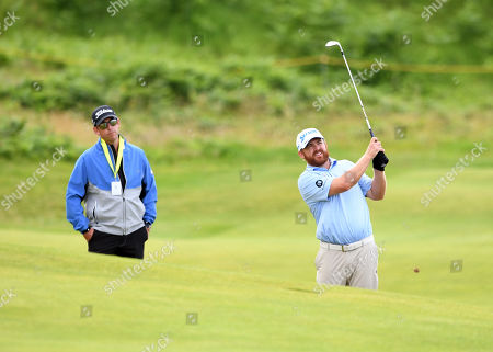 J. B. Holmes of the US plays from the fairway on the second practice day prior to the British Open Golf Championship at Royal Portrush, Northern Ireland, 16 July 2019.