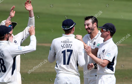 Toby Roland-Jones of Middlesex celebrates after Charlie Hemphrey is caught by John Simpson.