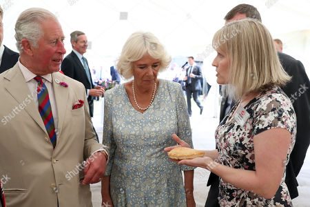 Production Director, Julie Roberts shows Prince Charles and Camilla Duchess of Cornwall around the bakery ahead of a garden party to celebrate the 50th anniversary of Ginsters Bakery in Callington
