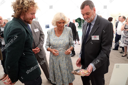 Paul Milner, Managing Director shows Ginster products to Camilla Duchess of Cornwall ahead of a garden party to celebrate the 50th anniversary of Ginsters Bakery in Callington