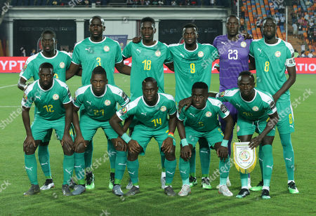 Senegal players pose for the group photo prior the 2019 Africa Cup of Nations (AFCON 2019) round of 16 soccer match between Uganda and Senegal in Cairo Stadium in Cairo, Egypt, 05 July 2019. (front row L-R) Youssouf Sabaly, Lamine Gassama, Henri Saivet, Idrissa Gueye, Sadio Mane, (back  row L-R) Badou N'Diaye, Kalidou Koulibaly, Ismaila Sarr, Mbaye Niang, goalkeeper Alfred Benmain Gomis, and Cheikou Kouyate.