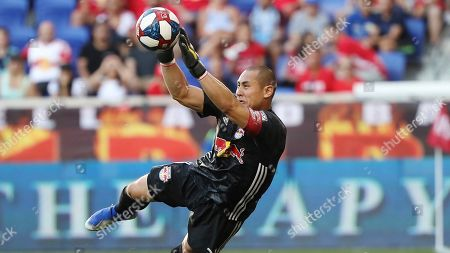 New York Red Bulls goalkeeper Luis Robles dives to make a save during the first half of an MLS soccer match against New York City FC, in Harrison, N.J. The New York Red Bulls won 2-1