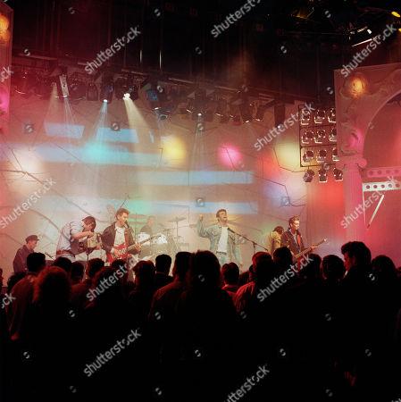 Pop Band: Wet Wet Wet: Marti Pellow (vocals), Graeme Clark (bass, vocals), Tommy Cunningham (drums, vocals), Neil Mitchell (keyboards) performing