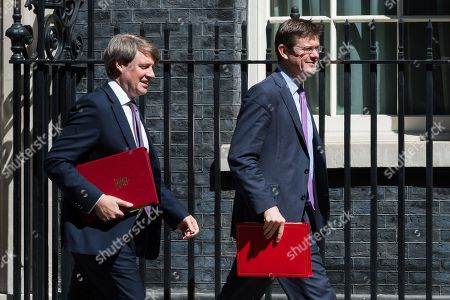 Minister of State for Universities, Science, Research and Innovation and Interim Minister of State for Energy and Clean Growth Chris Skidmore (L) and Secretary of State for Business, Energy and Industrial Strategy Greg Clark (R) leave 10 Downing Street after the weekly Cabinet meeting in London.