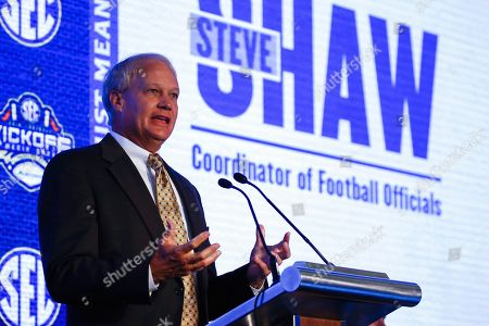 Steve Shaw, Coordinator of Officials, speaks during the NCAA college football Southeastern Conference Media Days, in Hoover, Ala
