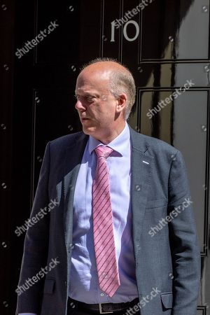 Chris Grayling, Secretary of State for Transport, arrives for the Cabinet meeting