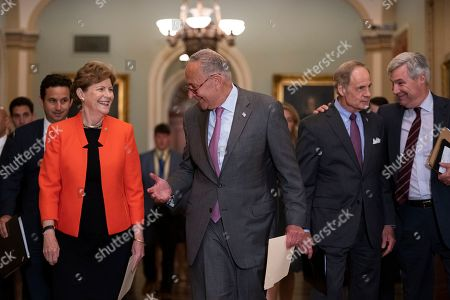 Chuck Schumer, Brian Schatz, Jeanne Shaheen, Tom Carper, Sheldon Whitehouse. Senate Minority Leader Chuck Schumer, D-N.Y., center, walks with members of his caucus, from left, Sen. Brian Schatz, D-Hawaii, Sen. Jeanne Shaheen, D-N.H., Sen. Tom Carper, D-Del., and Sen. Sheldon Whitehouse, D-R.I., as they arrive to speak with reporters, at the Capitol in Washington