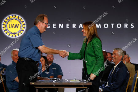 Gary Jones, Mary Barra. United Auto Workers President Gary Jones, left, and General Motors Chairman and Chief Executive Officer Mary Barra shake hands to open their contract talks Detroit
