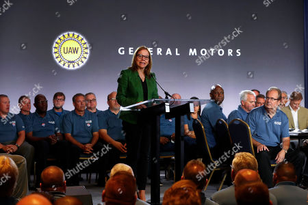 General Motors Chairman and Chief Executive Officer Mary Barra speaks as United Auto Workers President Gary Jones, right, listens to opening comments at their contract talks in Detroit
