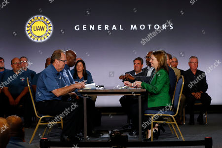 United Auto Workers President Gary Jones, left, and General Motors Chairman and Chief Executive Officer Mary Barra sit to open their contract talks in Detroit