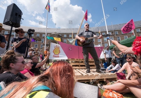 Billy Bragg attends the Extinction Rebellion week of action in Bristol. Billy gave a speech by the pink boat on Bristol Bridge and then marched with campaigners to the Youth XR gathering on College Green in front of City Hall where he sang some songs. Extinction Rebellion are holding a five-day 'occupation' of Bristol, by occupying Bristol Bridge in the city centre and traffic has to be diverted and carrying out other events. As part of a country-wide rebellion called Summer Uprising, followers will be holding protests in five cities across the UK including Bristol on the theme of water and rising sea levels, which is the group's focus for the South West.