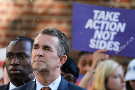 Ralph Northam, Levar Stoney. Virginia Gov. Ralph Northam, right, listens to speakers along with Richmond Mayor Levar Stoney, left, during a rally at the State Capitol in Richmond, Va. Northam is struggling to raise big money in a key election year after a blackface scandal nearly ended his political career. New campaign finance reports filed Monday, July 15 show the Democratic governor raised slightly more than $300,000 between April and June. That's far below the seven-figure hauls his predecessors, former Govs. Terry McAuliffe and Bob McDonnell, raised during similar periods when they were in office