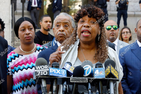 Gwen Carr, Reverend Al Sharpton. Gwen Carr, mother of chokehold victim Eric Garner, speaks outside the U.S. Attorney's office, in the Brooklyn borough of New York, as Rev. Reverend Al Sharpton listens, center. Federal prosecutors won't bring civil rights charges against New York City police officer Daniel Pantaleo, in the 2014 chokehold death of Garner, a decision made by Attorney General William Barr and announced one day before the five-year anniversary of his death, officials said