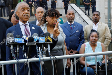 Reverend Al Sharpton, Gwen Carr, Esaw Snipes. Rev. Reverend Al Sharpton, left, speaks at a news conference outside the U.S. Attorney's office, in the Brooklyn borough of New York,. Gwen Carr, center, mother of chokehold victim Eric Garner is at center, and his widow Esaw Snipes is at right. Federal prosecutors won't bring civil rights charges against New York City police officer Daniel Pantaleo, in the 2014 chokehold death of Garner, a decision made by Attorney General William Barr and announced one day before the five-year anniversary of his death, officials said