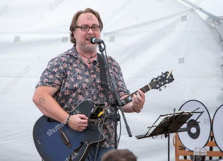 Stock Picture of Mitch Benn performs his show '10 Songs to Save the World' on day 1 of the festival
