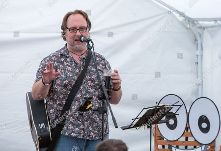 Stock Photo of Mitch Benn performs his show '10 Songs to Save the World' on day 1 of the festival