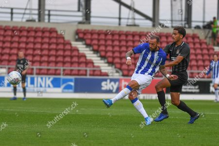 Sheffield Wednesday forward Steven Fletcher (9)  takes a shot at goal under pressure from Northampton Town defender Jay Williams (5) and hits the bar during the Pre-Season Friendly match between Northampton Town and Sheffield Wednesday at the PTS Academy Stadium, Northampton