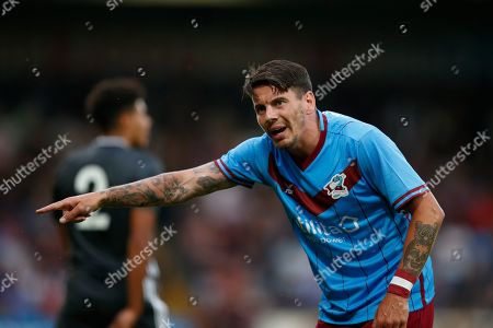 Adam Hammill Of Scunthorpe United protests to the officials during the Pre-Season Friendly match between Scunthorpe United and Leicester City at Glanford Park, Scunthorpe
