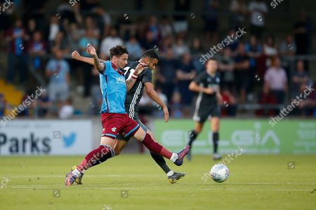 Adam Hammill Of Scunthorpe United challenges Rachid Ghezzal of Leicester City during the Pre-Season Friendly match between Scunthorpe United and Leicester City at Glanford Park, Scunthorpe