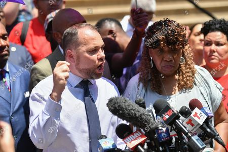 NYC Council Speaker Corey Johnson and Gwen Carr, Eric Garner's mother, speak at a press conference after the Justice Department declined to pursue federal charges against a New York City police officer in his 2014 death