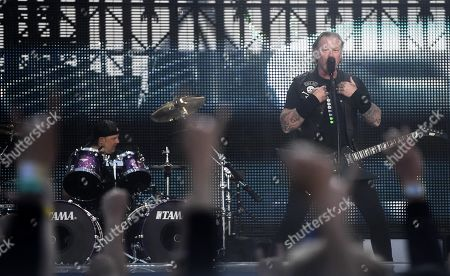 Metallica - Lars Ulrich and James Hetfield on stage during the band's Worldwired Tour concert