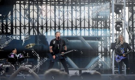 Metallica - Lars Ulrich, James Hetfield and Kirk Hammett on stage during the band's Worldwired Tour concert