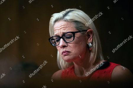 Stock Photo of Kyrsten Sinema, Steven Dillingham, Robert Goldenkoff, Nicholas Marinos. Senate Security and Governmental Affairs Committee member Sen. Kyrsten Sinema, D-Ariz., questions witnesses during a hearing on 2020 census on Capitol Hill in Washington