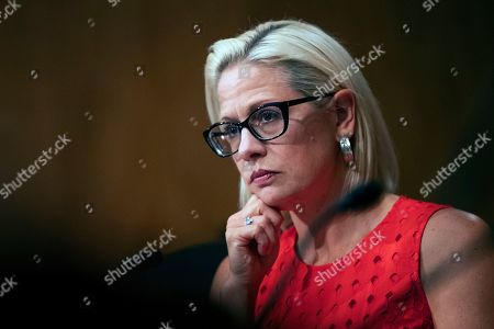 Kyrsten Sinema, Steven Dillingham, Robert Goldenkoff, Nicholas Marinos. Senate Security and Governmental Affairs Committee member Sen. Kyrsten Sinema, D-Ariz., listens to witnesses during a hearing on 2020 census on Capitol Hill in Washington