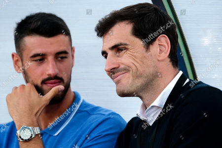FC Porto's Andre Pereira (L) and Iker Casillas (R) during a friendly soccer match between FC Porto and Fulham at Estadio Municipal de Albufeira, in Albufeira, Portugal, 16 July 2019.