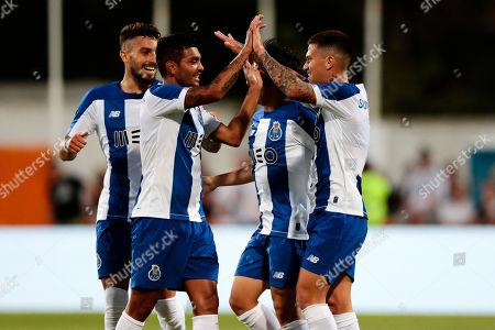 (L-R) FC Porto's Alex Telles, Jesus Manuel Corona, Shoya Nakajima and Otavio celebrate a goal against Fulham during a friendly soccer match between FC Porto and Fulham at Estadio Municipal de Albufeira, in Albufeira, Portugal, 16 July 2019.