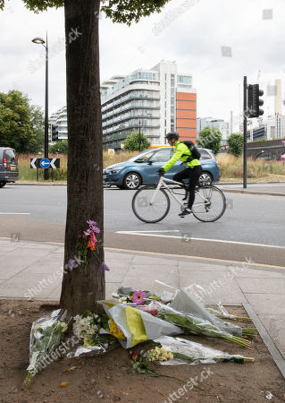 Flowers are laid in remembrance of Emily Hartridge who was killed when the electronic scooter she riding collided with a lorry just half a mile from her home in Battersea