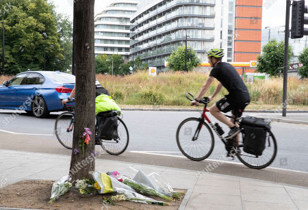 Stock Photo of Flowers are laid in remembrance of Emily Hartridge who was killed when the electronic scooter she riding collided with a lorry just half a mile from her home in Battersea