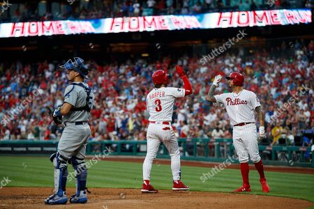 Bryce Harper, Vince Velasquez, Austin Barnes. Philadelphia Phillies' Bryce Harper, center, and Vince Velasquez, right, celebrate past Los Angeles Dodgers catcher Austin Barnes after Harper hit a three-run home run off starting pitcher Walker Buehler during the second inning of a baseball game, in Philadelphia