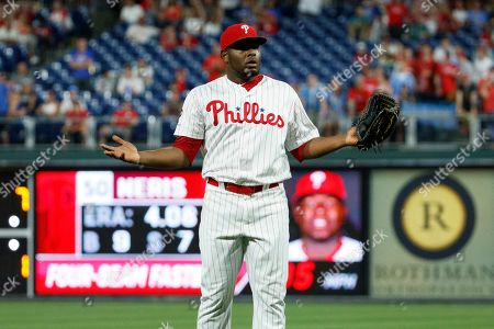 Philadelphia Phillies relief pitcher Hector Neris reacts after he was ejected for hitting Los Angeles Dodgers' David Freese with a pitch during the ninth inning of a baseball game, in Philadelphia. Philadelphia won 9-8