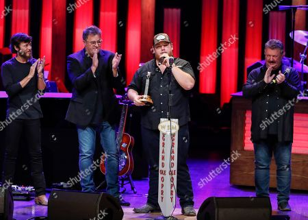 "Vince Gill, Luke Combs, Joe Diffie, Chris Janson. Chris Janson, left, Vince Gill and Joe Diffie, right, welcome Luke Combs to the Grand Ole Opry at ""Luke Combs Joins the Grand Ole Opry Family,"", in Nashville, Tenn"