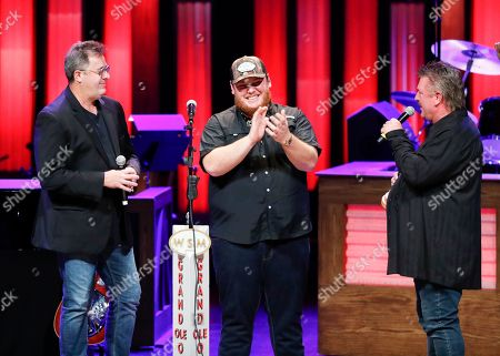 "Vince Gill, Luke Combs, Joe Diffie. Vince Gill, left, and Joe Diffie, right, welcome Luke Combs to the Grand Ole Opry at ""Luke Combs Joins the Grand Ole Opry Family,"", in Nashville, Tenn"