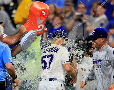 Glenn Sparkman, Brian Flynn, Danny Duffy. Kansas City Royals starting pitcher Glenn Sparkman (57) is doused by teammate Brian Flynn, left, as Danny Duffy, right, watches following the team's baseball game against the Chicago White Sox at Kauffman Stadium in Kansas City, Mo.,. The Royals won 11-0