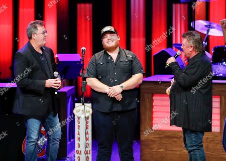 "Vince Gill, Luke Combs, Joe Diffie. Vince Gill, left, and Joe Diffie, right, speak with Luke Combs at ""Luke Combs Joins the Grand Ole Opry Family"" at Grand Ole Opry on in Nashville, Tenn"