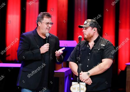 "Vince Gill, Luke Combs. Vince Gill, left, speaks with Luke Combs at ""Luke Combs Joins the Grand Ole Opry Family"" at Grand Ole Opry on in Nashville, Tenn"