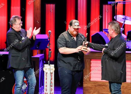 "Vince Gill, Luke Combs, Joe Diffie. Vince Gill, left, and Joe Diffie, right, welcome Luke Combs to the Grand Ole Opry Family at ""Luke Combs Joins the Grand Ole Opry Family"" at Grand Ole Opry on in Nashville, Tenn"