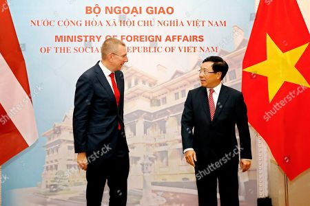 Vietnam's Minister of Foreign Affairs Pham Binh Minh (R) and Edgars Rinkevics (L), Minister for Foreign Affairs of Latvia, walk to a meeting room at the Government Guesthouse in Hanoi, Vietnam, 17 July 2019. Rinkevics is on an official visit to Vietnam from 16 July to 17 July 2019.