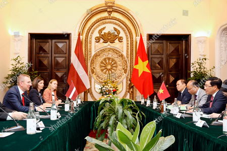 Vietnam's Minister of Foreign Affairs Pham Binh Minh (R) and Edgars Rinkevics (L), Minister for Foreign Affairs of Latvia, speak during meeting at the Government Guesthouse in Hanoi, Vietnam, 17 July 2019. Rinkevics is on an official visit to Vietnam from 16 July to 17 July 2019.