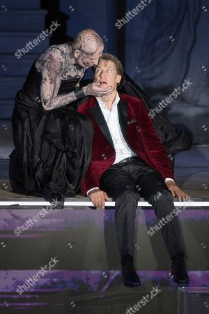 Peter Lohmeyer as death (L) and Tobias Moretti as Jedermann perform on stage during a rehearsal of Hugo von Hofmannsthal's Jedermann (Everyman) at the Domplatz square in Salzburg, Austria, 16 July 2019 (issued 17 July 2019). The play Jedermann, one of the highlights of the Salzburg festival, which was established in 1920, runs from 20 July to 31 August 2019.
