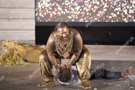 German actor Christoph Franken as Mammon (top) and Austrian actor Tobias Moretti as Jedermann (down) perform on stage during a rehearsal of Hugo von Hofmannsthal's Jedermann (Everyman) at the Domplatz square in Salzburg, Austria, 16 July 2019 (issued 17 July 2019). The play Jedermann, one of the highlights of the Salzburg Festival, which was established in 1920, runs from 20 July to 31 August 2019.