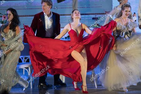 Tobias Moretti as Jedermann (C-L) and Russian actress Valery Tscheplanowa as Buhlschaft (C-R) perform on stage during a rehearsal of Hugo von Hofmannsthal's Jedermann (Everyman) at the Domplatz square in Salzburg, Austria, 16 July 2019 (issued 17 July 2019). The play Jedermann, one of the highlights of the Salzburg Festival, which was established in 1920, runs from 20 July to 31 August 2019.