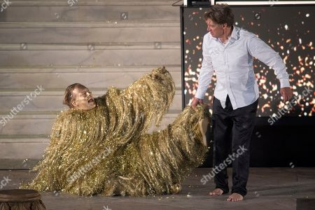 German actor Christoph Franken as Mammon (L) and Austrian actor Tobias Moretti as Jedermann (R) perform on stage during a rehearsal of Hugo von Hofmannsthal's Jedermann (Everyman) at the Domplatz square in Salzburg, Austria, 16 July 2019 (issued 17 July 2019). The play Jedermann, one of the highlights of the Salzburg Festival, which was established in 1920, runs from 20 July to 31 August 2019.