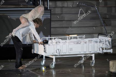 Tobias Moretti as Jedermann and Mavie Hoerbiger as Werke (top) perform on stage during a rehearsal of Hugo von Hofmannsthal's Jedermann (Everyman) at the Domplatz square in Salzburg, Austria, 16 July 2019 (issued 17 July 2019). The play Jedermann, one of the highlights of the Salzburg festival, which was established in 1920, runs from 20 July to 31 August 2019.